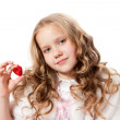 Lovely little girl showing chocolate candy — Stock Photo