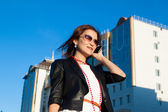 Attractive businesswoman using a cell phone in the city — Stok fotoğraf