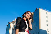 Attractive businesswoman using a cell phone in the city — Stock Photo