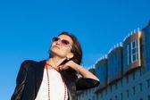Happy woman on a city street — Stok fotoğraf