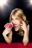 Young girl playing in the gambling — Stock Photo