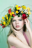 Beautiful woman with flower wreath — Stok fotoğraf