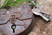 Gold ring on old lock — Stock Photo