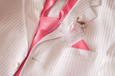 Wedding costume with pink necktie and buttonhole — Stock Photo