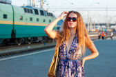 Woman waiting train on the platform — Stock Photo