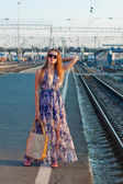 Woman waiting train on the platform — Stock Photo