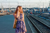Woman waiting train on the platform — ストック写真