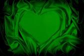 Green silk folded heart shape, useful for backgrounds — Stock Photo