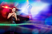 Clubber dancing and looking at camera with smile — Stock Photo