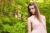 Young girl in the forest — Stock Photo