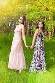 Young girls in the forest — Stock Photo