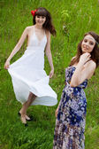 Young girls on the meadow — Stock Photo
