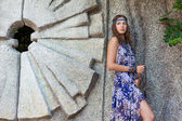 Woman in a sundress at the stone wall — Foto Stock