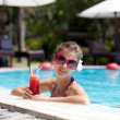 Beautiful girl in sunglasses with fresh watermelon juice in luxu — Stock Photo