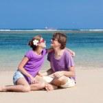 Young beautiful couple on tropical bali beach.honeymoon — Stock Photo #14466205