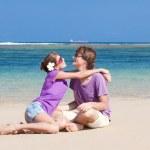 Young beautiful couple on tropical bali beach.honeymoon — Stock Photo #14466257