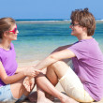 Young beautiful couple on tropical bali beach.honeymoon — Stock Photo
