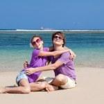 Young beautiful couple on tropical bali beach.honeymoon — Stock Photo #14466429