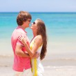 Beautiful young couple having fun on beach. honeymoon — Stock Photo #14634389
