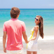 Beautiful young couple having fun on beach. honeymoon — Stock Photo #14634437
