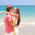 Beautiful young couple having fun on beach. honeymoon — Stock Photo