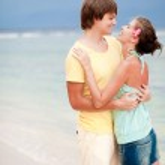Young happy couple having fun on tropical beach. honeumoon — Stock Photo #14634717