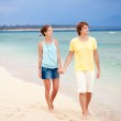 Young happy couple having fun on tropical beach. honeymoon — Stock Photo #14634971