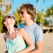 Young happy couple having fun on tropical beach. honeymoon — Stock Photo