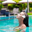 Half face portrait of beautiful woman in luxury pool — Stock Photo #16079831