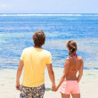 Stock Photo: Beautiful young couple looking on the horizon. honeymoom