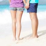 Young happy couple having fun on tropical beach. honeymoon — Stock Photo