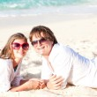 Young happy couple having fun on tropical beach. honeymoon — Stock Photo #18904793