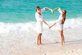 Young happy couple having fun on tropical beach. honeymoon — Stok fotoğraf