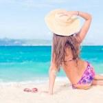 Long haired girl in bikini on tropical bali beach — Stock Photo #18984239