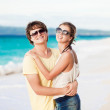 Young happy couple having fun on tropical beach. honeymoon — Stock Photo #18984611