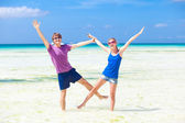 Happy young couple having fun on the beach — Stock Photo