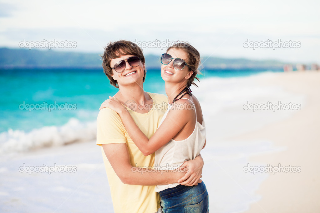 Young happy couple having fun on tropical beach. honeymoon  Stock Photo #18984611