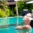 Half face portrait of beautiful woman in luxury pool — Stock Photo