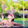 Portrait of young attraactive smiling woman in luxury pool — Stock Photo #19288101