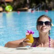 Beautiful girl in sunglasses with fresh mango juice in luxury po — Stock Photo #19289641