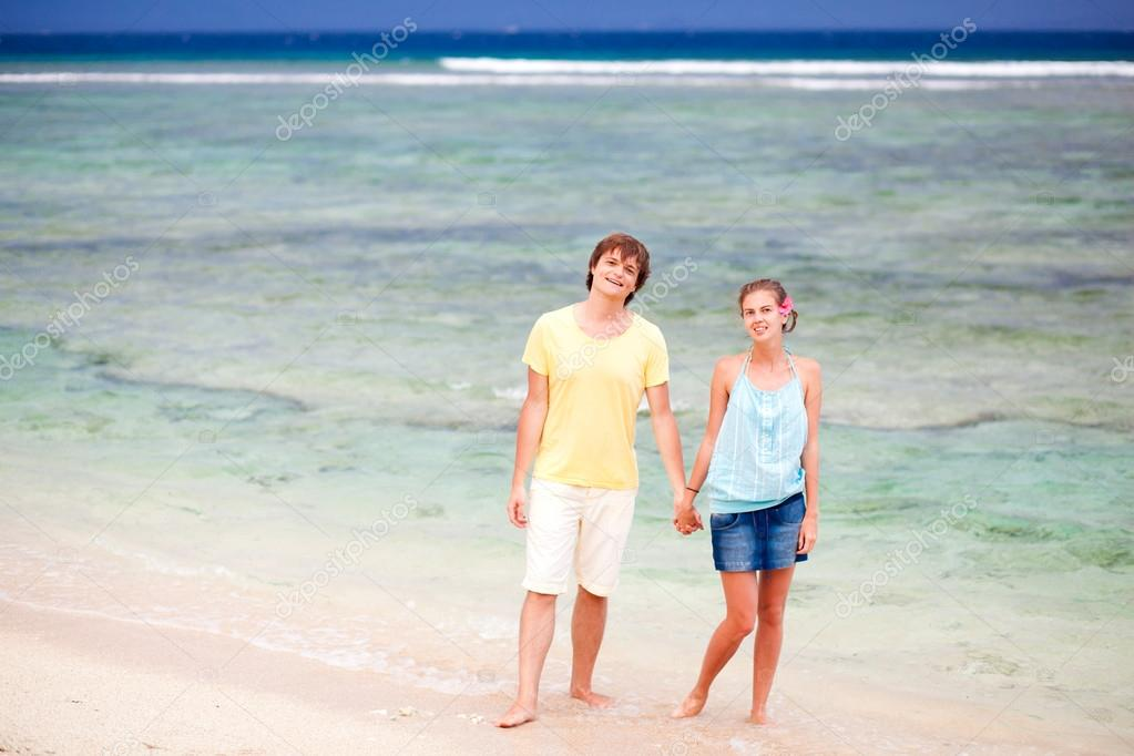 Young happy couple having fun on tropical beach. honeymoon — Stock Photo #19288727