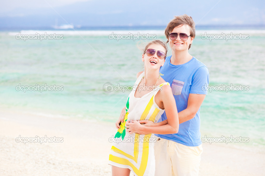 Young happy couple having fun on tropical beach. honeymoon — Stock Photo #19289649