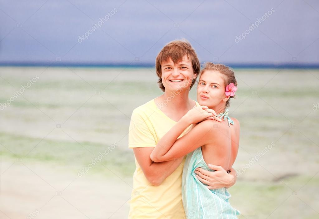 Young happy couple having fun on tropical beach. honeymoon — Stock Photo #19289667