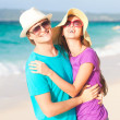 Young happy couple having fun on tropical beach. honeymoon — Stock Photo #22298683