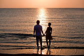 The image of two in love at sunset — Stock Photo