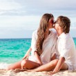 Young happy couple having fun on tropical beach. honeymoon — Foto Stock