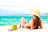 Young woman in bikini and straw hat with fresh coconut — Stock Photo