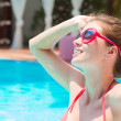 Portrait of young beautiful woman in pool — Stock Photo