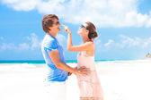 Couple having fun on beach. — Stock Photo