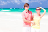 Young couple having fun on beach. honeymoon concept — Stok fotoğraf
